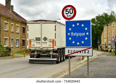 Truck crossing a border sign of European Union member Belgium.
