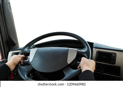 Truck dashboard with driver's hands on the steering wheel isolated on a white background