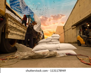 The truck delivery sugar in bag to store in warehouse and pick up by labor