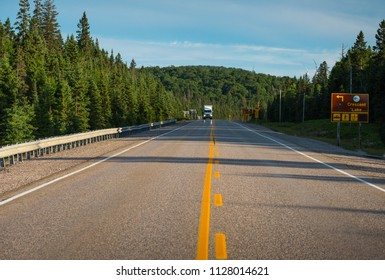 Truck in distance on Trans Canada highway north of Lake Superior