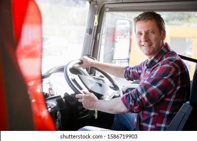 Truck driver in cab of semi-truck