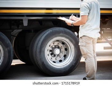 truck driver holding clipboard inspecting safety checklist semi truck, vehicle maintenance daily checklist, road freight industry logistics.