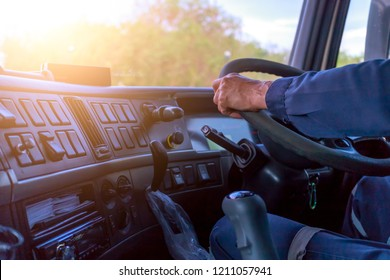 Truck driver keeps driving with hands,The man Behind Semi Truck Steering Wheel.