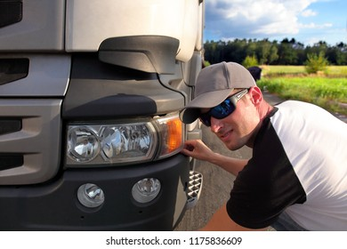 Truck driver on the road with trucks