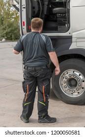 Truck driver opens the driver's door