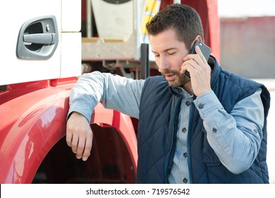 truck driver tending a client on the phone