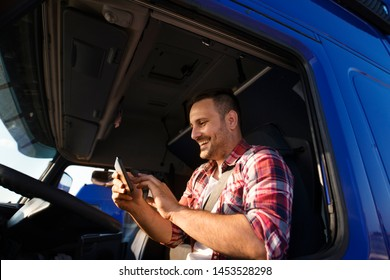 Truck driver using tablet for GPS navigation to the destination. Using modern technologies in transport industry.