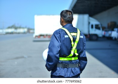 The Truck driver is waiting for the job.