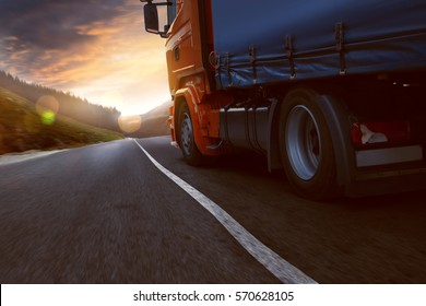 Truck drives into sunset