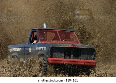 truck drives through mud