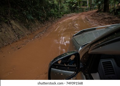 truck is driving on the Muddy road or the damage of rural road after raining