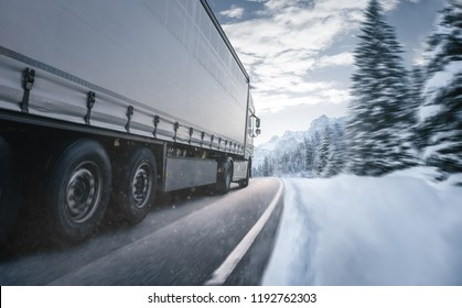 Truck is driving on a wintry country road