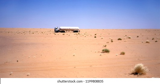 Truck driving through the Arab desert between Iraq and Jordan
