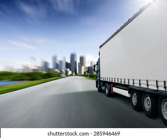 Truck driving towards big city