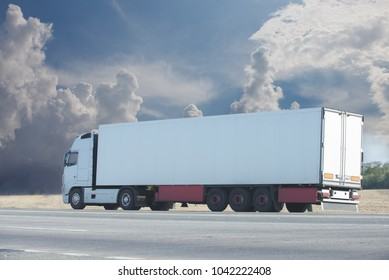 The truck driving towards sunset
