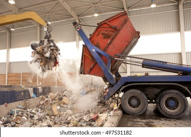 Truck dumps waste to the incinerator, grab take the rubbish