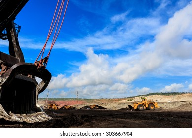 Truck and Electric Shovel in Open Pit and blue sky