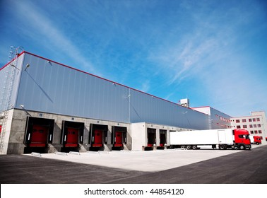 truck in front of an industrial logistics building