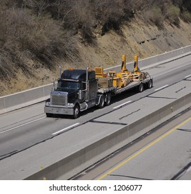 Truck with Heavy Equipment Parts on the Highway