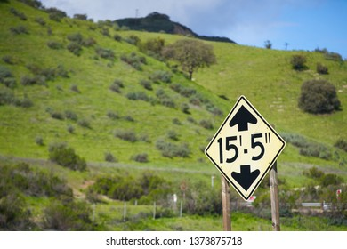 Truck height warning as approaching bridge