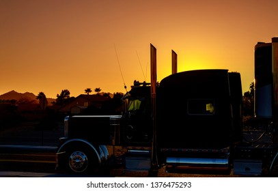 Truck highway road with transporting on the asphalt expressway against sky during sunset