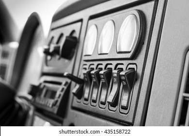 Truck interior dashboard panel in black and white - close up