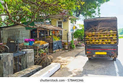The truck laden with coconuts stands at the old fruit stall, Madampe, Sri Lanka.