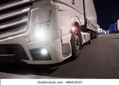truck with lights on at night