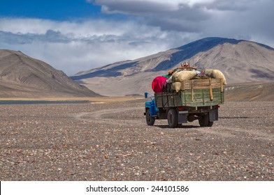 Truck loaded with goods on the road in Pamir mountains in Tajikistan