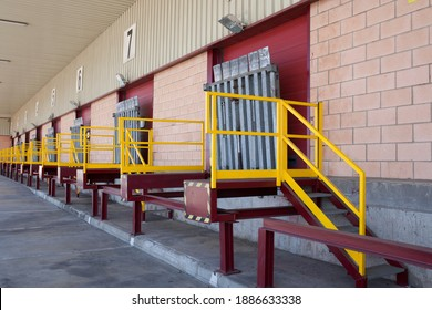 Truck loading docks at commercial building. Overhead door, dock leveler, and dock seals - Shutterstock ID 1886633338