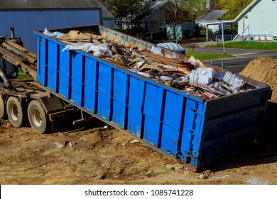 Truck loading a full skip recycling garbage waste management container