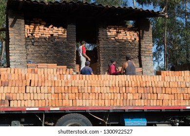 Truck loads bricks directly from the wood furnace