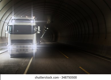 Truck in a long road tunnel