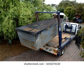 Truck (lorry) loading a full skip waste management container