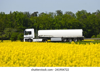 Truck is made against a field of rape from the biodiesel