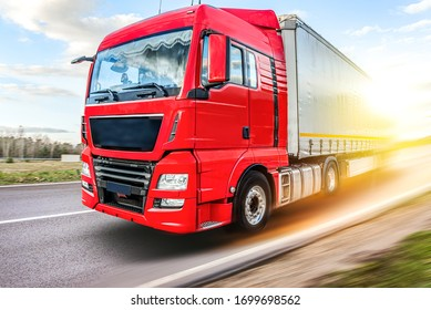 Truck moves on the road at speed, delivery of goods.