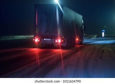 truck is moving along the winter road at night