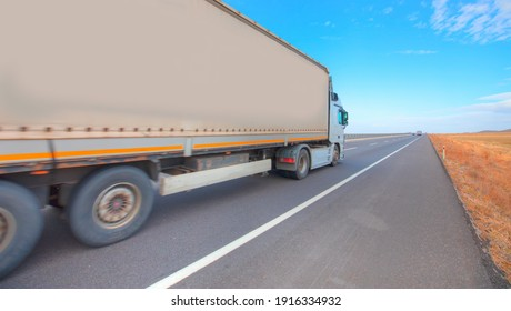 Truck on the asphalt road - Commercial cargo delivery truck