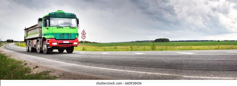 truck on asphalt road. lorry delivering cargo