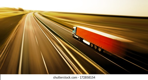 Truck on asphalt road motion blur