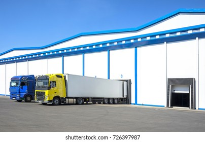 Truck on car parking near warehouse. Delivery and shipping concept