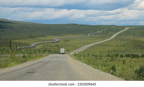 Truck on the Dalton Highway to the Alyeska Trans Alaska Pipeline (TAPS) and pipeline access road near the Arctic