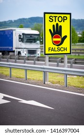 Truck on the highway in the austrian countryside with the STOP/ FALSCH (stop / false) sign to warn the drivers