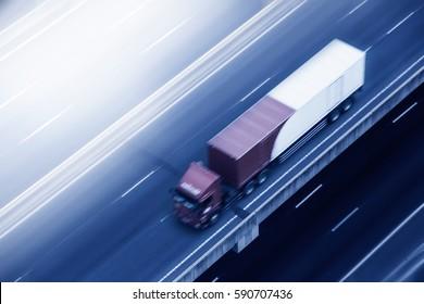 Truck on highway motion blur.