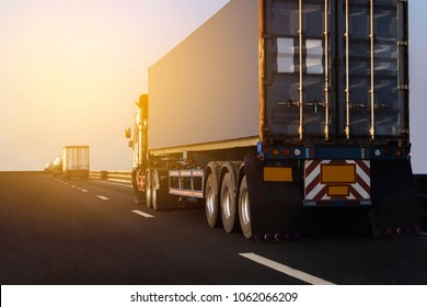 Truck on highway road with big container, transportation concept.,import,export logistic industrial Transporting Land transport on asphalt expressway
