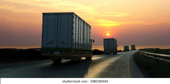 Truck on highway road with container, transportation concept.,import,export logistic industrial Transporting Land transport on asphalt expressway with sunrise sky