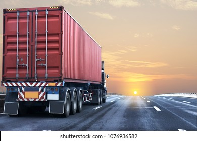 Truck on highway road with red  container, transportation concept.,import,export logistic industrial Transporting Land transport on the asphalt expressway with sunrise sky