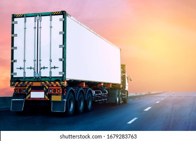Truck on highway road with white container, transportation concept.,import,export logistic industrial Transporting Land transport on asphalt expressway with sunrise sky