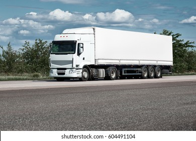 Truck on road, blue sky, cargo transportation concept