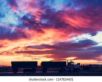 truck on the road with colorful sunset cloudy sky.